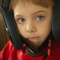Young boy in a helmet.
