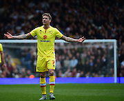 MK Dons Midfielder Carl Baker (7) questions the linesman during the Sky Bet Championship match between Fulham and Milton Keynes Dons at Craven Cottage, London, England on 2 April 2016. Photo by Jon Bromley.