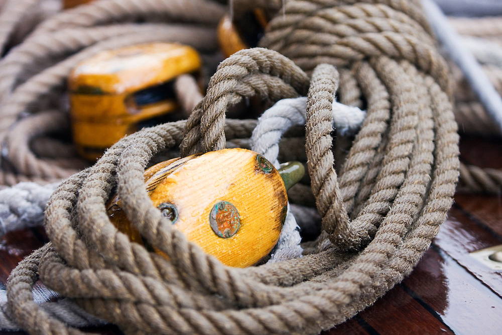 A tangle of blocks and rope on board the schooner yacht SY Altair, during the 2008 Antigua Classic Yacht Regatta . This race is one of the worlds most prestigious traditional yacht races. It takes place annually off the cost of Antigua in the British West Indies. Antigua is a yachting haven, historically a British navy base in the times of Nelson.