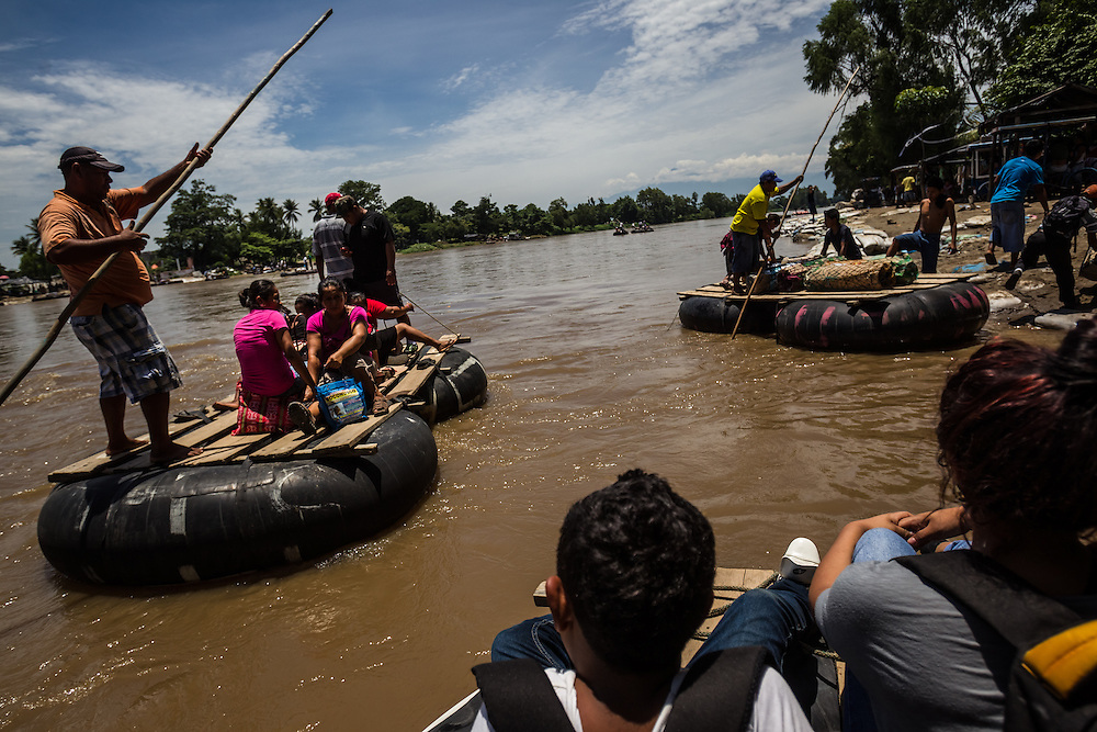 CIUDAD HIDALGO, MEXICO - MAY 28, 2014: 15-year-old Jensury and her 11-year-old brother Claudio, from Honduras, are smuggled across the Suchiate river on a raft between the Mexico and Guatemala border at the Tecúm Umán and Ciudad Hidalgo crossing. Jensury witnessed members of the Mara-18 gang murder one of her neighbors, so the gang tried to kill her too, albeit unsuccessfully. She has been fleeing for her life ever since, traveling without immigration papers. PHOTO: Meridith Kohut for The New York Times
