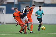 Dundee&rsquo;s Michael Duffy forces his way between two United defenders - Dundee v Dundee United in the SPFL Development League at Links Park, Montrose. Photo: David Young<br /> <br />  - &copy; David Young - www.davidyoungphoto.co.uk - email: davidyoungphoto@gmail.com