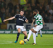 20th September 2017, Dens Park, Dundee, Scotland; Scottish League Cup Quarter-final, Dundee v Celtic; Dundee's Lewis Spence and Celtic's Olivier Ntcham