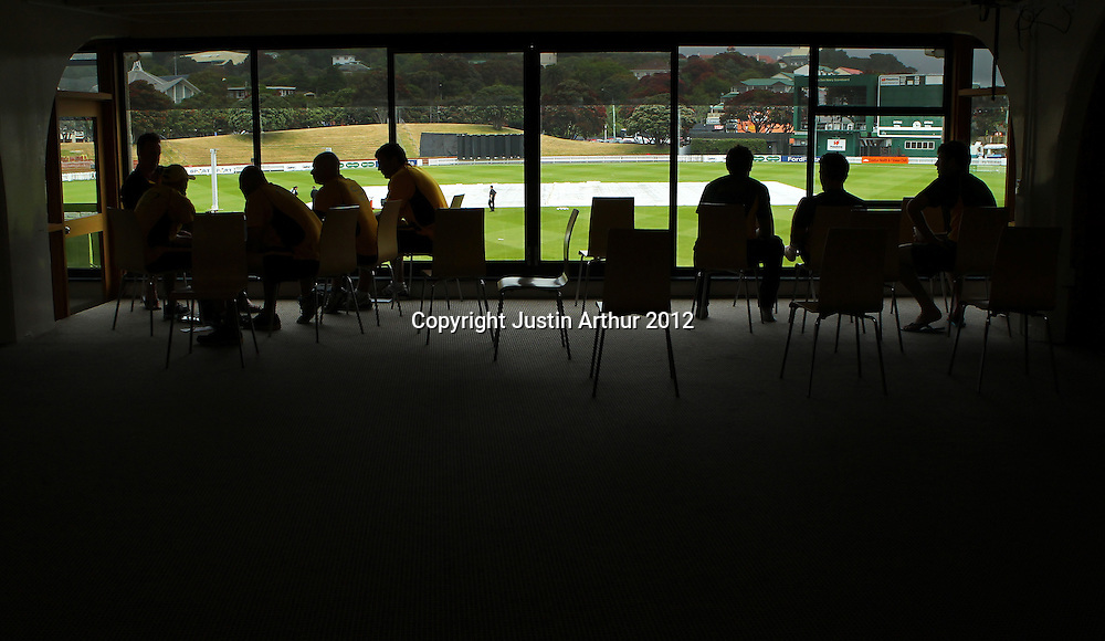 Players wait for the start of play during the 2012/2013 HRV Cup Twenty20 session. Wellington Firebirds v Central Stags at the Basin Reserve, Wellington, New Zealand on Wednesday 26 December 2012. Photo: Justin Arthur / photosport.co.nz