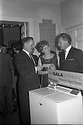 17/12/1962<br /> 12/17/1962<br /> 17 December 1962<br /> A.E.I. Gala reception at Shangri-la Hotel, Dalkey, Dublin, where a Gala Supermatic washing machine was presented to the Variety Club of Ireland for their Easter Draw by Gala. Pictured are Mr. P.N. Walsh, Area Manager for Ireland, (right) handing over the prize to Mr. Des O'Keefe, Chief Barker of the Variety Club of Ireland. Centre is Mrs P.N. Walsh.