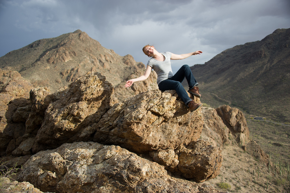 Woman relaxing on rocks, Grants Pass, Tucson Arizona