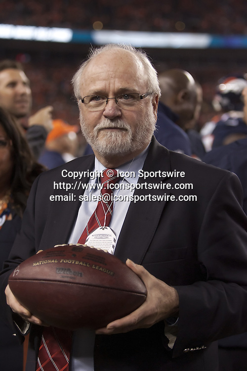 Oct. 19, 2014 - Denver, Colorado, U.S - Vice President - Communications/Exhibits at Pro Football Hall of Fame, JOE HORRIGAN holds Broncos QB PEYTON MANNINGS RECORD #509 TD ball as he readies to send it to the NFL Pro Football Hall of Fame during the 1st. half at Sports Authority Field at Mile High Sunday afternoon. The Broncos beat the 49ers 42-17