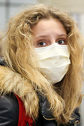 © Licensed to London News Pictures. 04/03/2020. London, UK. A non-Asian commuter wearing a protective face mask at Tottenham Court Road station. Thirty four new cases of Coronavirus have been confirmed in the UK, taking the total number to eighty five. Photo credit: Dinendra Haria/LNP