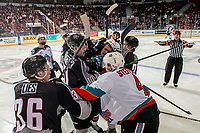 KELOWNA, BC - JANUARY 4: Referee Kyle Kowalski and line official Cody Wanner attempt to restore order after the Kelowna Rockets and the Vancouver Giants get in one another's faces during second period at Prospera Place on January 4, 2020 in Kelowna, Canada. (Photo by Marissa Baecker/Shoot the Breeze)