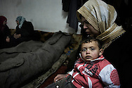 SYRIA - Homs province: Family members mourning their beloved two  relatifs, killed after a mortar explosion in his house, Homs province on February 20, 2012. ALESSIO ROMENZI