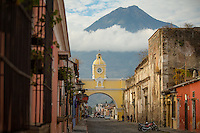 Antigua, Guatemala - March 12 , 2015:  Volcán de Agua presides over the 17th Century Santa Catalina Arch in downtown Antigua. Known for it's Spanish Baroque architecture, cobblestone streets and repurposed colonial mansions, the former capital of the Kingdom of Guatemala has been designated a UNESCO World Heritage Site. CREDIT: Chris Carmichael for The New York Times
