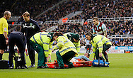 Kevin Long of Burnley is carried off the pitch during the Barclays Premier League match at St. James's Park, Newcastle<br /> Picture by Simon Moore/Focus Images Ltd 07807 671782<br /> 01/01/2015