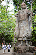 Pilgrims and a statue of the Buddhist monk Kūkai (Kōbō Daishi) on the island of Shikoku, Tokushima Prefecture, Japan.