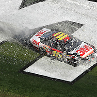 Sprint Cup Series driver Greg Biffle (16) crashes across the infield of the Daytona 500 Sprint Cup race at Daytona International Speedway on February 20, 2011 in Daytona Beach, Florida. (AP Photo/Alex Menendez)