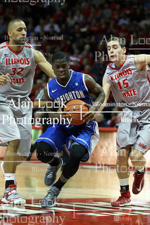 02 January 2013:  Austin Chatman storms the lane past Jackie Carmichael and Nick Ziesloft during an NCAA Missouri Vally Conference (MVC) mens basketball game between the Creighton University Bluejays and the Illinois State Redbirds in Redbird Arena, Normal IL