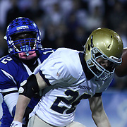 Middletown Wide Receiver Chris Godwin (12) watches as the ball deflects off of Salesianum defender Colby Reeder (28) helmet in the third quarter of the DIAA State Championship football game against Salesianum Saturday, Nov. 30 2013, at Delaware Stadium in Newark Delaware.