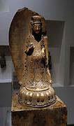 Bodhisattva Avalokitesvara holding a lotus flower.  Wei Dynasty 534-550 AD Chinese Marble.