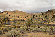 A windy, curvy road (Highway 218, Oregon) in the central oregon desert.