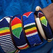 Closeup of African American wearing five colorful ornamental beaded bracelets from Africa.