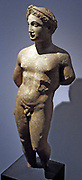 Statue of a naked youth.  About 300-100 BC, Cyprus, local limestone.  Wears hair in braids, wrapped around his head, fastened by a thin head-band.  This hairstyle suggests that he might be the god Apollo.