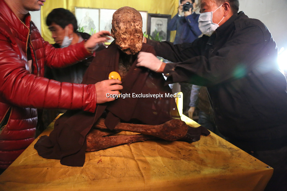 QUANZHOU, CHINA - JANUARY 10: (CHINA OUT) <br /> <br /> monk Fuhous body which was found not rotted after putting in a vat for three and a half years at Puzhao temple on Zimao Mountain on January 10, 2016 in Quanzhou, Fujian Province of China. 94-year-old monk Fuhou died in 2012 and his body was put by the sitting position into a vat with a cover for three and a half years. Monks found that Fuhous body wasn\'t rotted on an opening vat rite on January 10 at Puzhao temple on Zimao Mountain in Quanzhou. The body would be cleaned and stuck with gold to be made into a golden Buddha. <br /> &copy;Exclusivepix Media