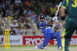 © Licensed to London News Pictures. 08/03/2012. Adelaide Oval, Australia. Nuwan Kulasekara plays a cover drive during the One Day International cricket match final between Australia Vs Sri Lanka. Photo credit : Asanka Brendon Ratnayake/LNP