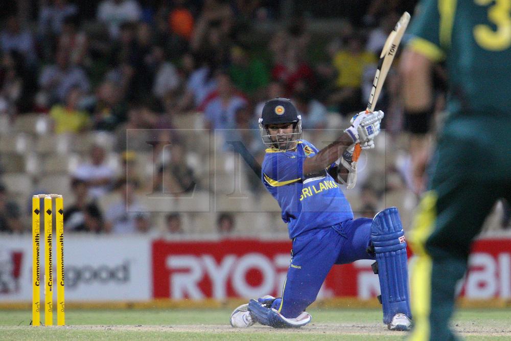 © Licensed to London News Pictures. 08/03/2012. Adelaide Oval, Australia. Nuwan Kulasekara plays a cover drive during the One Day International cricket match final between Australia Vs Sri Lanka. Photo credit : Asanka Brendon Ratnayake/LNP