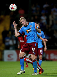 Neil Bishop of Scunthorpe United heads the ball - Mandatory by-line: Robbie Stephenson/JMP - 23/08/2016 - FOOTBALL - Glanford Park - Scunthorpe, England - Scunthorpe United v Bristol City - EFL Cup second round