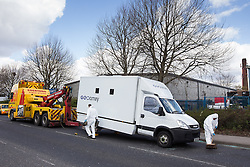 © Licensed to London News Pictures . 30/04/2013 . Salford , Greater Manchester , UK . The prison van is towed away . Police and forensic scenes of crime examiners at the scene on Regent Road , Salford , where a prison van was hijacked this morning (Tuesday 30th April) . Police report that two prisoners escaped . Photo credit : Joel Goodman/LNP