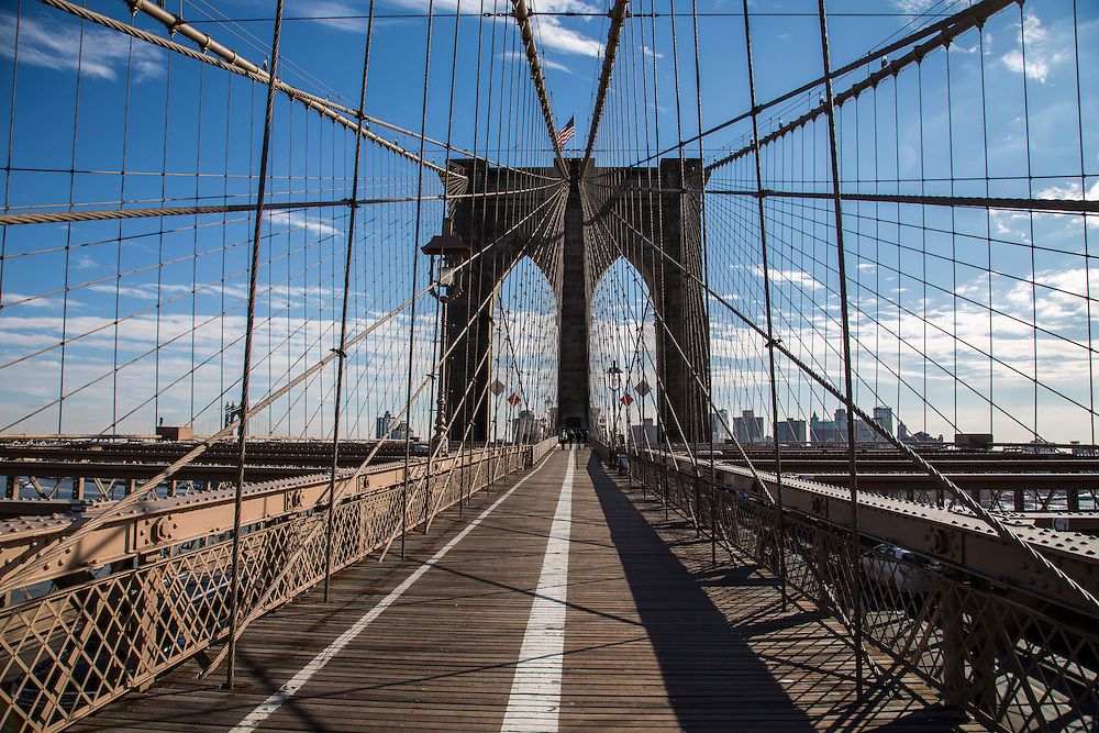 A view from the pedestrian walkway of Brooklyn Bridge towards Lower Manhattan, New York City, United States of America.  The bridge's cables form a distinctive weblike pattern.  It is estimated more than 4,000 pedestrians cross the bridge every day.  The iconic city skyline can be seen in the background.  (photo by Andrew Aitchison / In pictures via Getty Images)