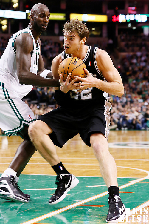 21 November 2012: San Antonio Spurs power forward Tiago Splitter (22) drives past Boston Celtics power forward Kevin Garnett (5) during the San Antonio Spurs 112-100 victory over the Boston Celtics at the TD Garden, Boston, Massachusetts, USA.