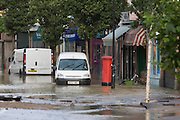 Local vehicles belonging to local businesses in deep water after a burst water main closed the otherwise busy junction of Half Moon Lane and Dulwich Road in the south London area of Herne Hill. At about 5am, emergency crews were called when water inundated local homes and businesses, forcing residents to evacuate their properties and leave before electricity supplies were shut down.