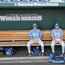 Jun 24, 2013; Omaha, NE, USA; UCLA Bruins catcher Shane Zeile (14) and pitcher Ryan Deeter (40) sit in the dugout before game 1 of the College World Series finals against the Mississippi State Bulldogs at TD Ameritrade Park. Mandatory Credit: Derick E. Hingle-USA TODAY Sports