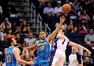 Apr 7, 2013; Phoenix, AZ, USA; New Orleans Hornets guard Eric Gordon (10) reaches for the ball against Phoenix Suns guard Goran Dragic (1) in the second half at US Airways Center. The Hornets defeated the Suns 95-92. Mandatory Credit: Jennifer Stewart-USA TODAY Sports