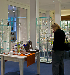 "Meissen, Saxony:  Shopper contemplates a purchase in the Meissen showroom boutique.  Known as the ""Cradle of Saxony,"" the city of Meissen also has held a world-wide reputation since the 17th century for the quality of its porcelain.  Guided tours through the Meissen Royal Porcelain Workshop take visitors through each stage of china creation and then allow them to wander through both an extensive museum and a boutique. The china often is referred to as ""white gold."""
