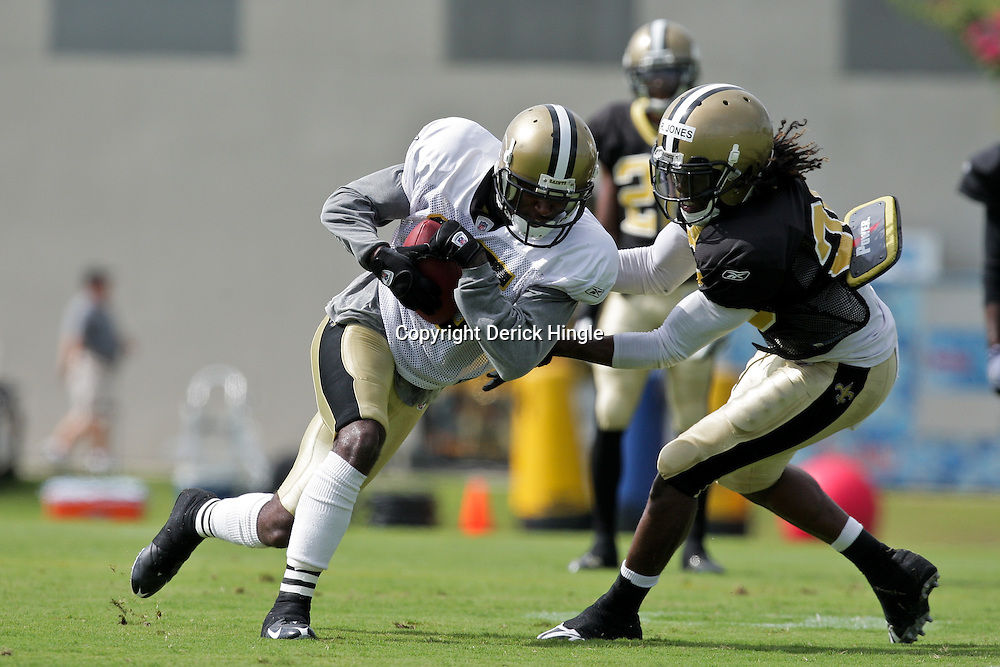 01 August 2009: New Orleans Saints wide receiver Courtney Roby (15) catches a ball in front of cornerback Reggie Jones (35) during New Orleans Saints training camp at the team's practice facility in Metairie, Louisiana.