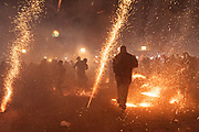Dozens of sky rockets explode around celebrants in the chaos of the Alborada festival in front of the Parroquia San Miguel Archangel church September 29, 2018 in San Miguel de Allende, Mexico. The unusual festival celebrates the cities patron saint with a two hour-long firework battle at 4am representing the struggle between Saint Michael and Lucifer.
