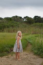 little girl walking on the beach in a pretty dress in East Hampton, NY