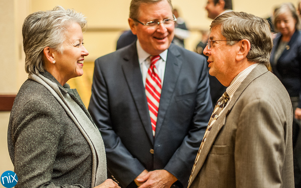 North Carolina Secretary of Commerce Sharon Decker talks with newly-elected Kannapolis Mayor Darrell Hinnant  prior to a town-hall style meeting at Embassy Suits in Concord Friday afternoon.