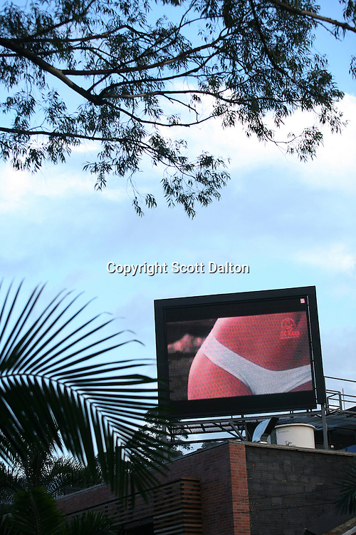 A clothing advertisement runs on an outdoor video screen in a park in an upper class neighborhood in Medellin on Friday, April 27, 2007. (Photo/Scott Dalton)