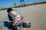 In the basketball court, a boy builds his own kite. There are few recreation moments for the children in the agricultural farm fields. Culiacan, Sinaloa. <br /> SPANISH: En la cancha de basketball un ni&ntilde;o construye un papalote. Son pocos los espacios para esparcimiento que los ni&ntilde;os tienen en los campos agr&iacute;colas. Culiacan, Sinaloa. 2008.