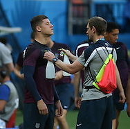 Ross Barkley of England is cooled down using a water spray during the England open training session at Arena da Amazonia, Manaus, Brazil. <br /> Picture by Andrew Tobin/Focus Images Ltd +44 7710 761829<br /> 13/06/2014