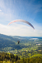 United States, Washington, Issaquah. Paragliders launch from Tiger Mountain and soar westward towards Issaquah.