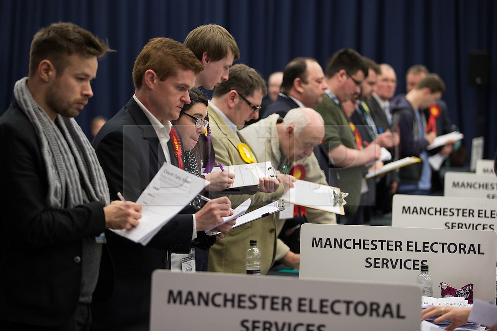 © Licensed to London News Pictures . 13/02/2014 . Manchester , UK . Watching the count . The count for the Wythenshawe and Sale East by-election , at Manchester Central this evening . Photo credit : Joel Goodman/LNP