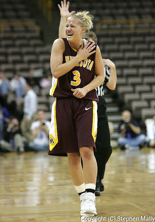 25 JANUARY 2007: Minnesota guard Kelly Roysland (3) grabs her shoulder which was injured in the first half in Iowa's 80-78 overtime loss to Minnesota at Carver-Hawkeye Arena in Iowa City, Iowa on January 25, 2007.