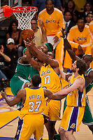 17 June 2010: Center Andrew Bynum of the Los Angeles Lakers grabs a rebound as Rasheed Wallacw of the Boston Celtics reaches for the ball during the first half of the Lakers 83-79 championship victory over the Celtics in Game 7 of the NBA Finals at the STAPLES Center in Los Angeles, CA.