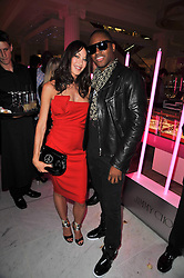 TAMARA MELLON and TAIO CRUZ at the launch of Project PEP to benefit the Elton John Aids Foundation hosted by Tamara Mellon and Diana Jenkins in association with Jimmy Choo held at Selfridges, Oxford Street, London on 29th October 2009.