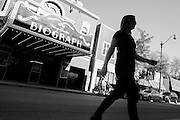 A woman crosses Lincoln Avenue across from the Biograph Theater where John Dillinger was infamously shot in 1934 in Chicago's Lincoln Park neighborhood.