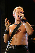 Billy Idol performs with his band at the House Of Blues in New Orleans, Louisiana on Monday, September 28, 2015. The 59 year old English rocker had many costume changes and was not shy to take his shirt off.