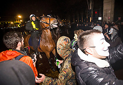 © Licensed to London News Pictures. 05/11/2015. London, UK. Masked demonstrators clash with mounted police during An anti-capitalist  protest organised by the group Anonymous outside Parliament in Westminster on bonfire night 05, November 2015. Bonfire night, also known as Guy Fawkes night, is an annual commemoration of when Guy Fawkes, a member of the Gunpowder Plot, was arrested for attempting to blow up the House of Lords at parliament.   Photo credit: Ben Cawthra/LNP