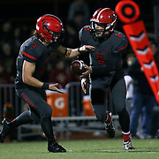 November 06, 2015; Oregon City, OR, USA; CONNOR MITCHELL (5)  is handed the ball.  Oregon City hosted Southridge at Pioneer Stadium.  Photo by David Blair